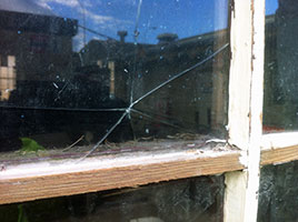 replace broken glass in timber sash window.